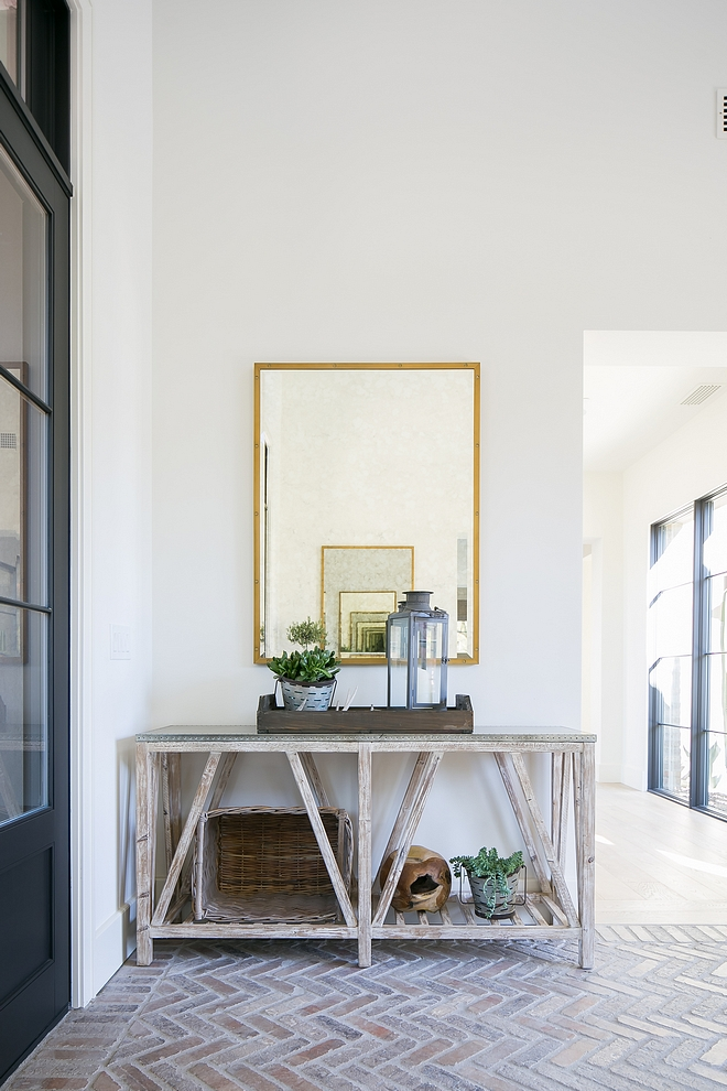 Wooden base console table with zinc top Foyer decor ideas Wooden base console table with zinc top with brass mirror and rustic decor #Woodenbase #consoletable #foyer