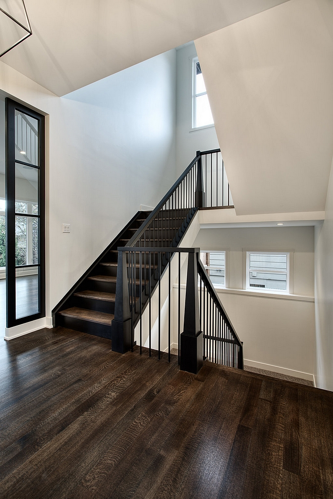 Black staircase paint color Black Newel posts, railing and spindles are painted in Benjamin Moore Black #BenjaminMooreBlack #blackstaircase #paintcolor