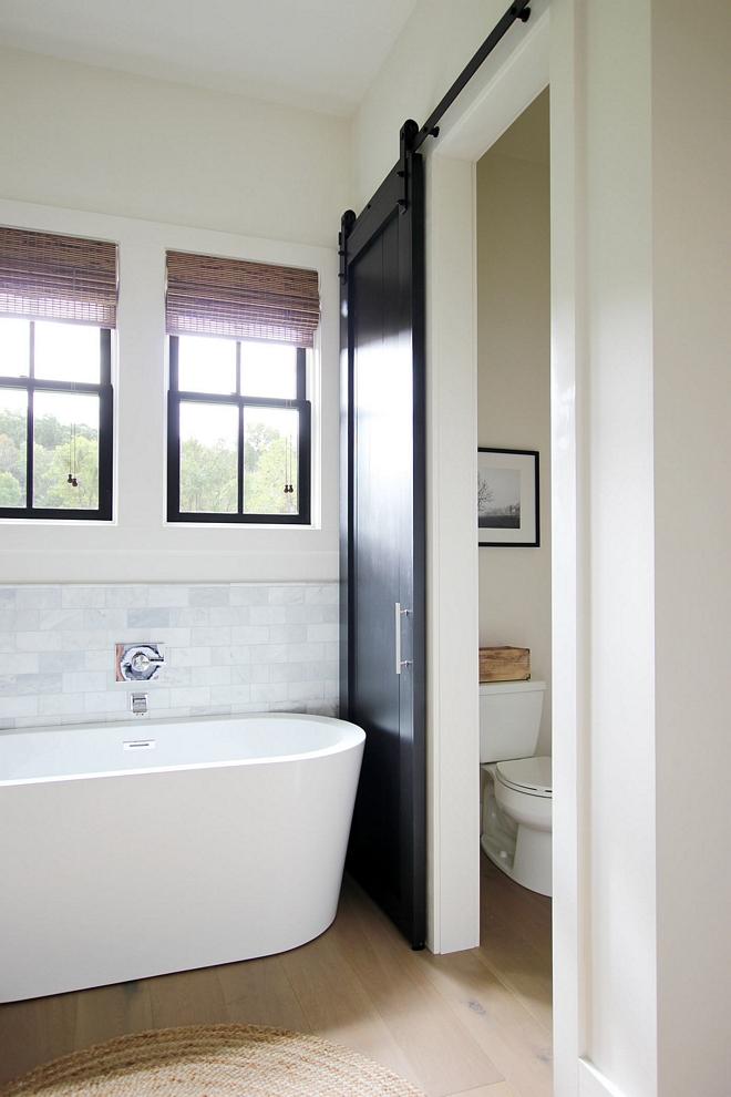 DIY Bathroom Barn Door on water closet DIY custom made DIY Bathroom Barn Door Sherwin Williams Tricorn Black -Satin Finish DIY Bathroom Barn Door Sherwin Williams Tricorn Black #DIYBarnDoor #BathroomBarnDoor #SherwinWilliamsTricornBlack