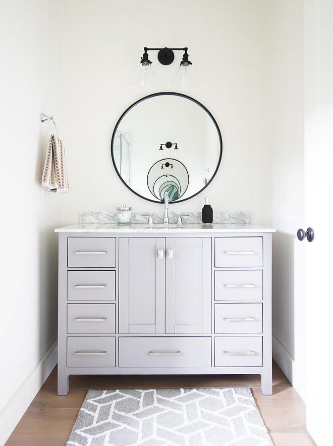 Grey vanity 48-inch vanity with Carrara Marble Top Not custom 48-inch vanity with Carrara Marble Top Bathroom vanity see source on Home Bunch 48-inch with Carrara Marble Top #48inchvanity #CarraraMarblevanity #bathroomvanity