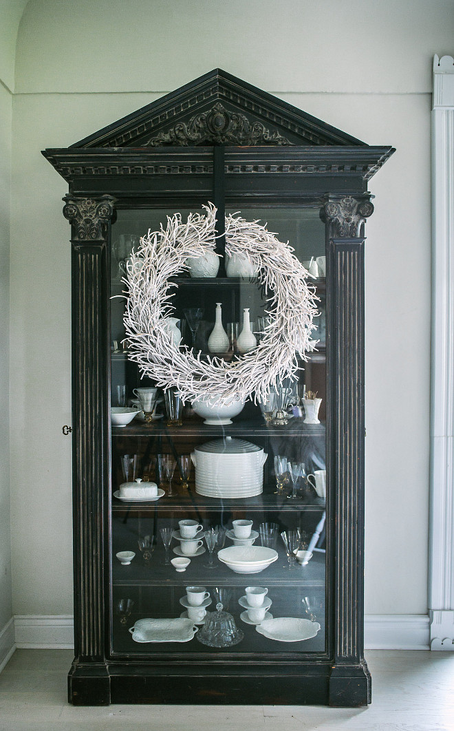 Sometimes high impact can be achieved through simplicity… a wreath hung with wide black ribbon is all that was needed to dress my china cabinet
