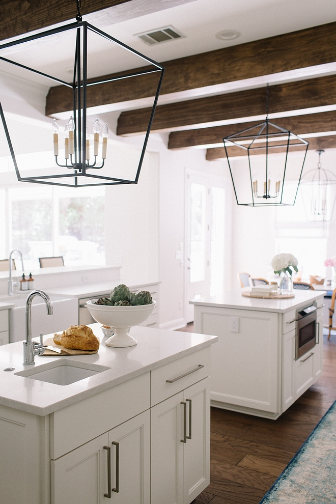 Kitchen island with two prep-islands, large ceiling beams, large pendant light over kitchen islands #kitchenisland #kicthenislands #largependantlight #doublekitchenisland #kitchens #kitchen #ceilingbeams #largebeams