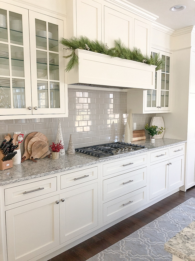 Off white kitchen painted in White Dove by Benjamin Moore with grey subway tile