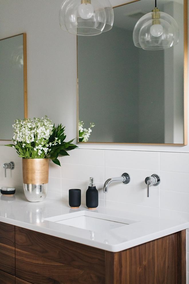 Faucet is a wall-mount lavatory faucet and countertop is white quartz; Perla White Quartz #whitequartz #PerlaWhiteQuartz #Quartz
