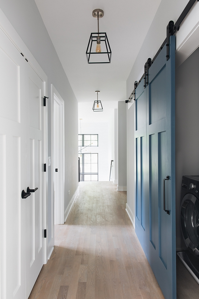 Blue barn door Laundry room with blue grey barn door Barn door painted in blue Barn door #barndoor #bluebarndoor #laundryroombarndoor #laundryroom