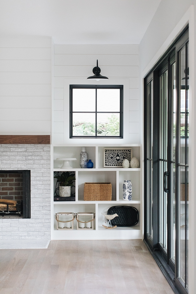 Fireplace built-ins The fireplace is flanked by asymmetrical built-ins with windows and shiplap above #fireplace #builtins #shiplap #windowabovebuiltin #asymmetricalbuiltin