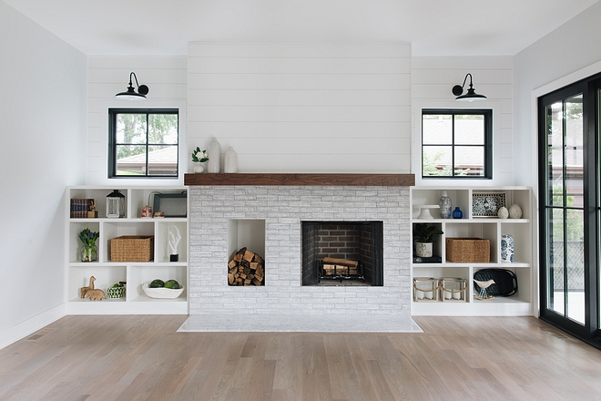 Farmhouse Fireplace with wood storage The fireplace features a brick-style tile and a dedicated wood storage space Modern farmhouse fireplace with log storage #farmhousefireplace #fireplace #woodstoragefireplace #fireplacewoodstorage #logstorage