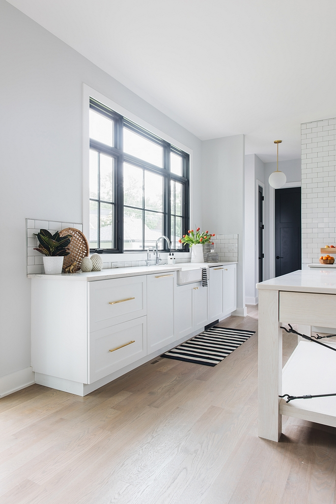Kitchen with no upper cabinets No upper cabinets on kitchen On this side of the kitchen you will find only lower cabinets and a large window above the kitchen sink. You could add floating shelves, but honestly speaking I prefer this clean and airy look #kitchencabinets #lowercabinets #nouppercabinets