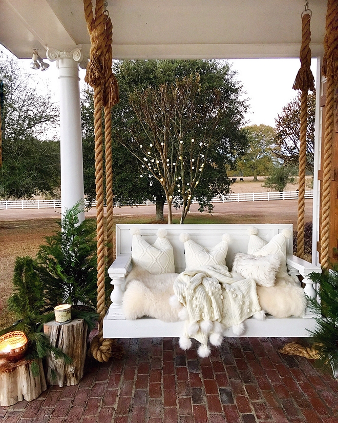 Porch swing rope handle porch swing with pompom throw and pompom pillows Porch swing rope handle Porch swing rope handle ideas #Porchswing #ropeporchswing #porch #swing