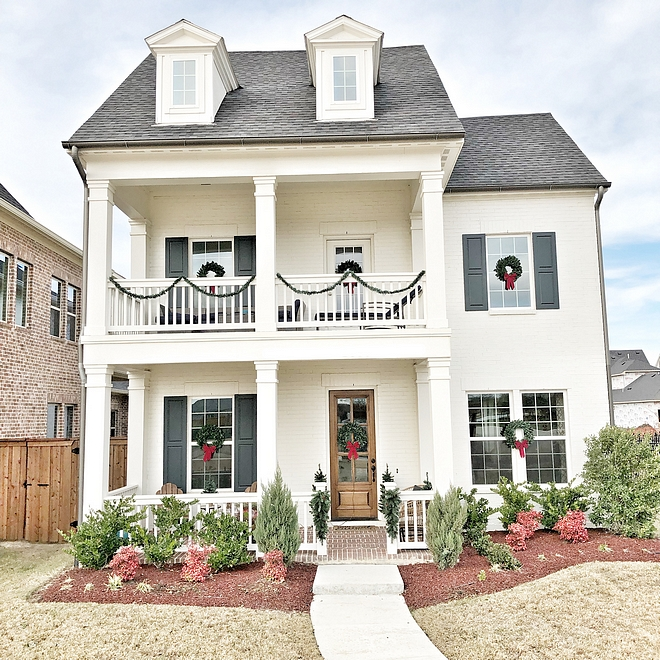 Christmas Exterior Decorating Ideas Classic and simple not excessive Christmas decor Classic Christmas Exterior Decor with wreath and garland Wreath on windows #Christmasexteriordecor #Christmasdecor #Christmas