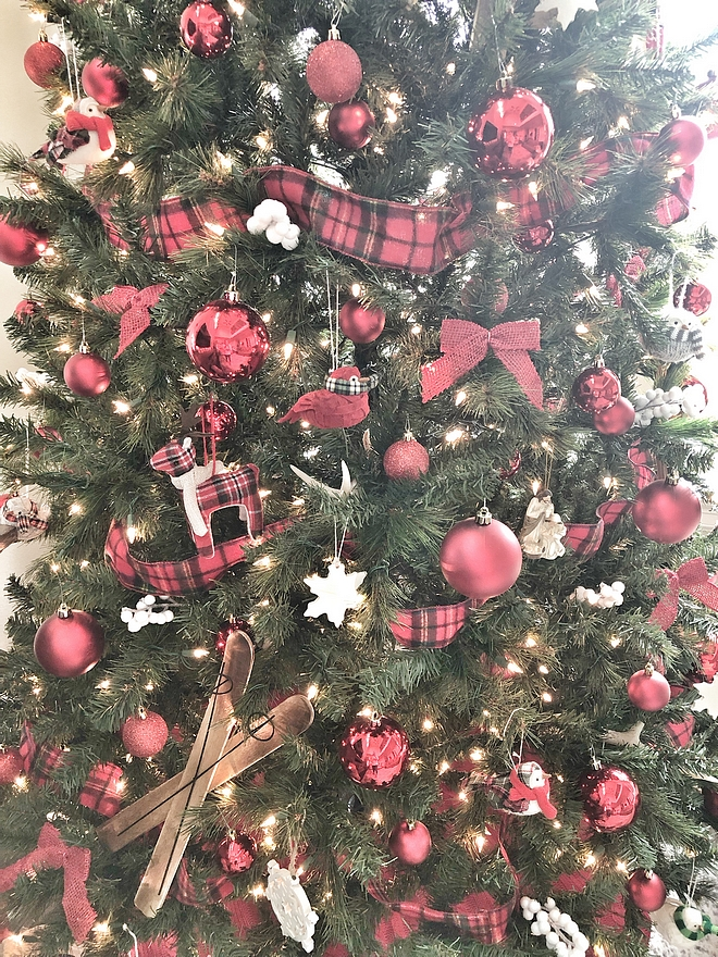 I add plaid ribbon weaved in and out of the tree because it adds so much to the tree #Christmas #plaid #Christmastree