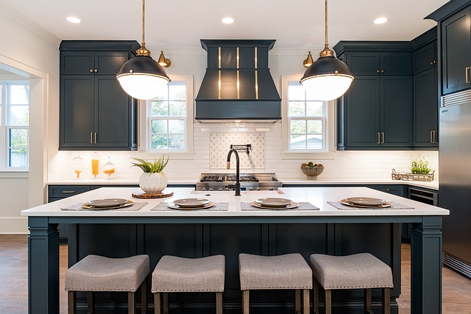 Kitchen island The center island comfortably seats 4, perfect for casual dining A designer faucet catches your eye as you glance upon this stylish kitchen Note the picture frame tile accent above the range Kitchen island #Kitchenisland