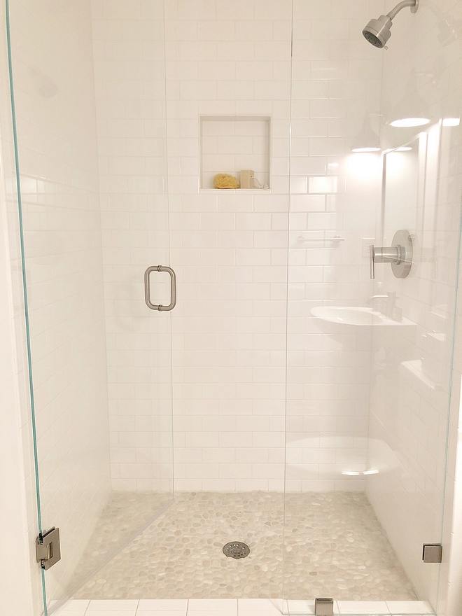 Bathroom Renovation Shower Tile We redid the shower with a riverstone floor tile and white subway tile Bathroom Renovation Shower Tile #BathroomRenovation #ShowerTile