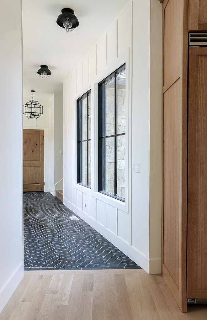 Benjamin Moore Simply White OC-117 The back entry features a stone herringbone floor tile and board and batten walls painted in Benjamin Moore Simply White OC-117 #BenjaminMooreSimplyWhiteOC117