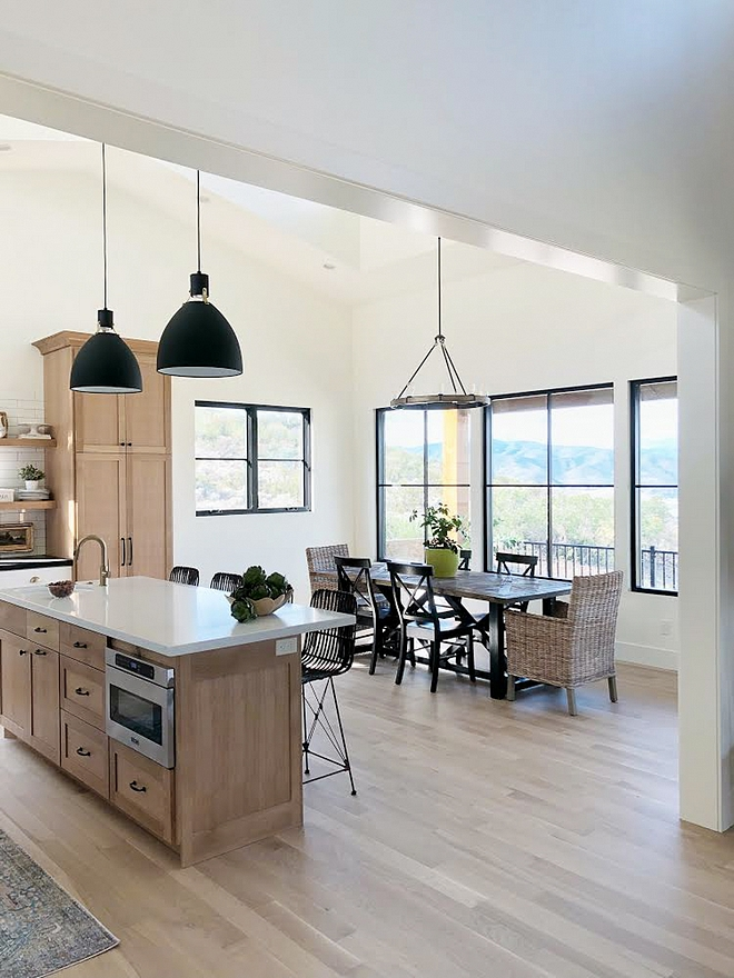 Modern Farmhouse dining room with black steel windows walls in Benjamin Moore Simply White and White Oak cabinets #ModernFarmhousediningroom #blacksteelwindows