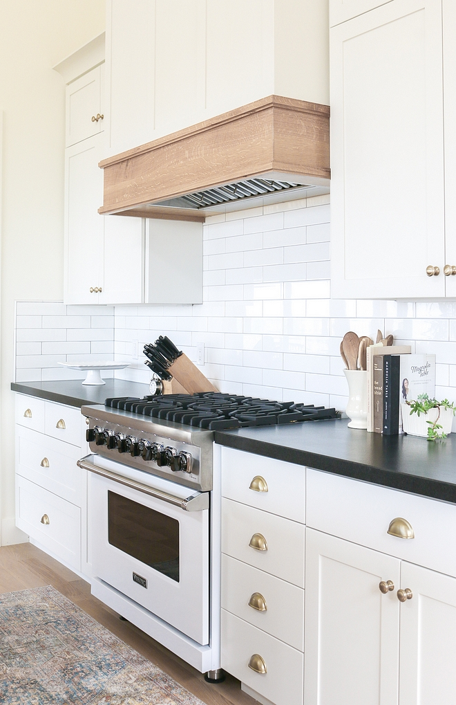 White kitchen cabinet with White Oak Hood White oak hood mantel with a clear protective finish #Whitekitchen #kitchencabinet #WhiteOakHoodmantel #WhiteOakhood #hoodmantel