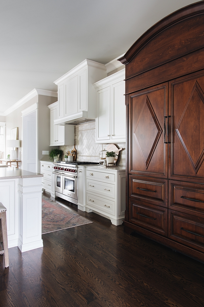 Kitchen features white inset, custom-designed and crafted cabinetry and medium-stained refrigerator cabinet #kitchen #kitchencabinet #Kitcheninsetcabinet #cabinet #cabinetry #refrigeratorcabinet