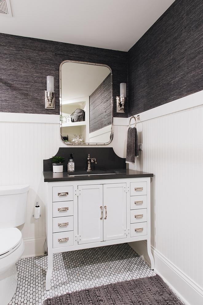 Bathroom with beadboard wainscoting, Metal Bathroom Vanity, wallpaper and oval marble mosaic floor tile #bathroom #beadboardwainscoting #wainscoting #ovalmosaictile #metalvanity