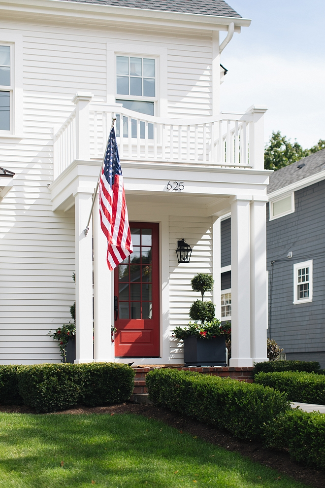 White home siding with red door White siding paint color Benjamin Moore OC17 White Dove Red Door paint color Benjamin Moore Raspberry Truffle #BenjaminMoore #paintocolors #BenjaminMoorepaintcolor #BenjaminMooresiding #BenjaminMoorewhitedove #reddoor