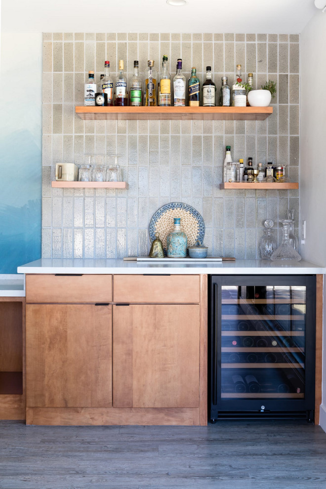 Bar with flat-faced cabinet, flowating shelves and Glazed terracotta tile as backsplash #bar #Glazedterracottatile #Glazedtile