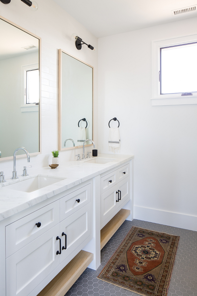 Modern Farmhouse bathroom with double vanity Cabinets are Shaker-style face framed with bottom white oak shelves #bathroom #doublevanity #Cabinet #Shakerstylecabinet #faceframedcabinet #whiteoakshelves