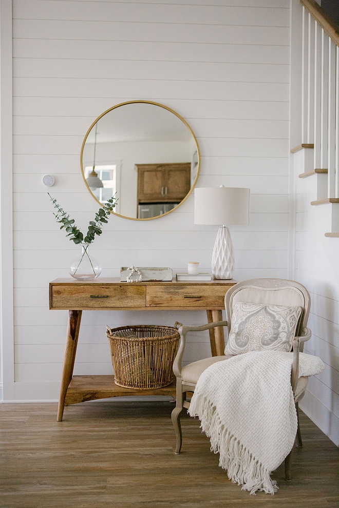 Foyer decor inspiration The foyer also features shiplap walls and a Mid-century inspired console table Foyer decor inspiration Foyer decor inspiration #Foyer #foyerdecorinspiration