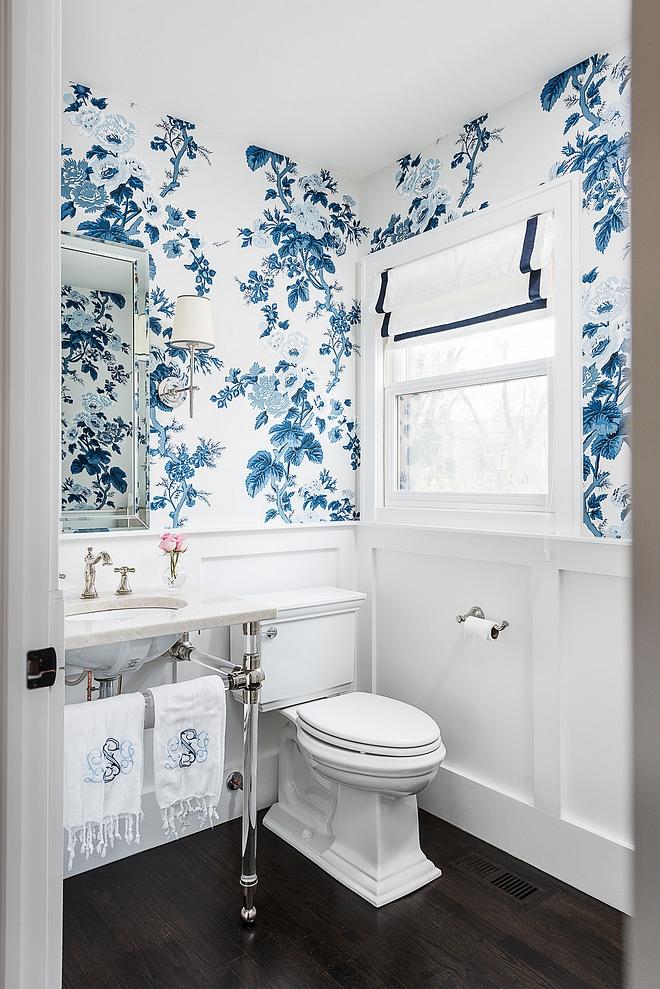 Powder Bathroom Powder Bath features classic wainscoting, blue and white floral wallpaper, acrylic bathroom basin and a dramatic dark hardwood flooring #PowderBathroom #PowderBath #Bathroom #wainscoting #wallpaper