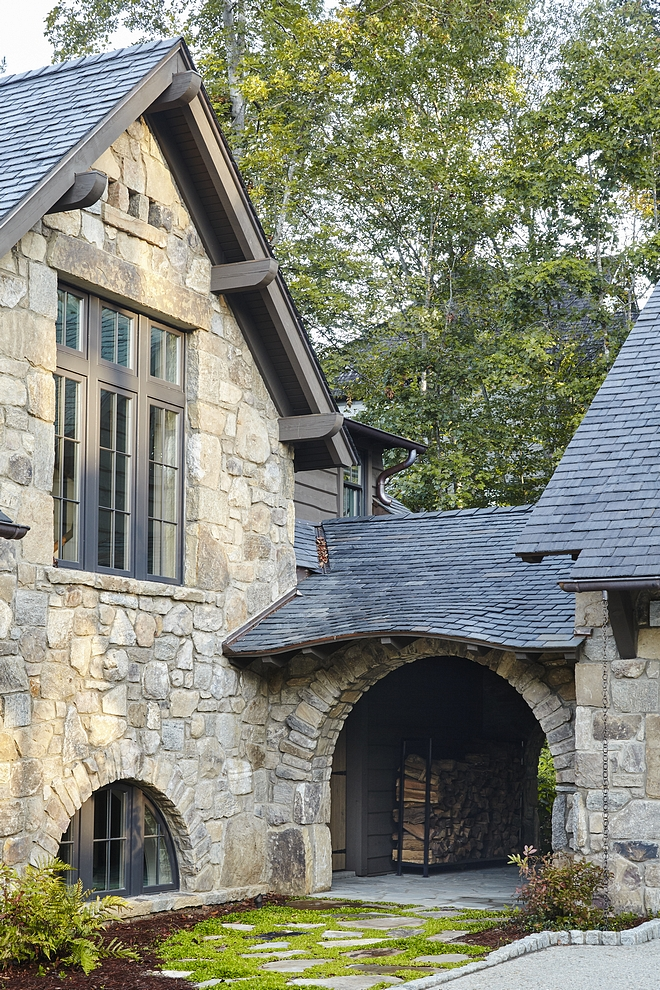 Arched breezeway Stone breezeway An arched breezeway between the garage and mudroom door adds character to this classic rustic lakeside home #archedbreezeway #breezeway #stonebreezeway