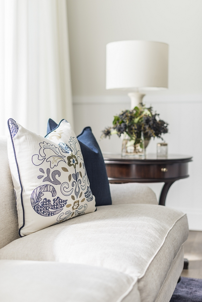Blue and white pillows The living room features the same restful palette of whites, greys and navy Blue and white color scheme Classic blue and white interiors Traditional Blue and white decor Blue and white interior design #blueandwhite #colorscheme #blueandwhiteinteriors #blueandwhitedecor #traditionalinteriors