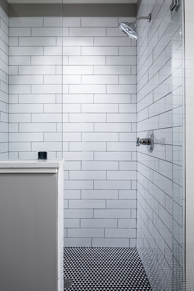 Shower Wall is 4x16 White Matte subway with standard gray grout #shower #tile #grout