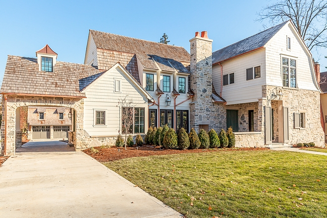 Stone Exterior The exterior layers materials such as stone, siding, cedar shake and copper accents The charming porte cochere features a cupola and serves as an entry point to the two story detached garage Stone Exterior #StoneExterior #Exterior #portecochere #stone #siding