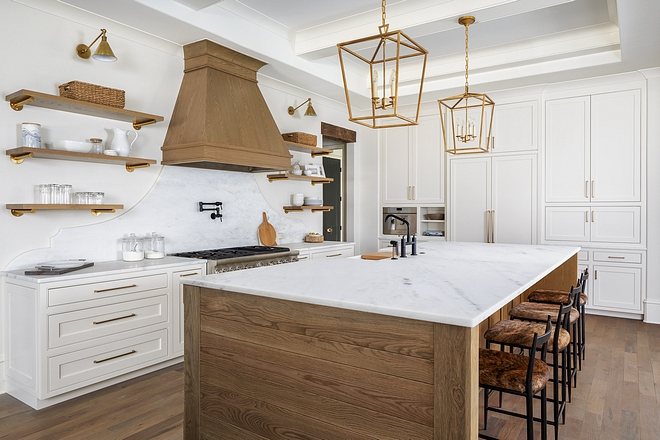 Kitchen Cabinetry Color Benjamin Moore White Dove Custom inset cabinetry fills this kitchen and provides for ample storage space. A cabinet front Refrigerator is hidden where the tall pair of doors are on the center of the wall of cabinetry #Kitchen #Cabinetry #kitchencabinetry #BenjaminMooreWhiteDove #Customcabinet #customkitchencabinet #insetcabinetry