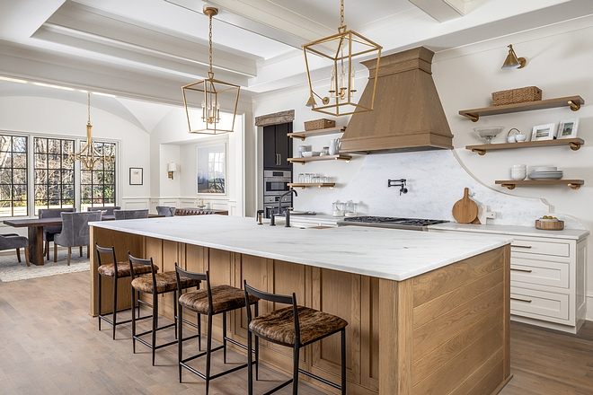 Open Kitchen We love this angle of the kitchen because it shows the open concept to the family dining room. A cased opening allows for each room to remain its own space, while still keeping the open concept buyers demand in this day in age, and allowing plentiful natural light to flow into the kitchen #kitchen #kitchenlayout #diningroom #kitcheninspo #kitchengoals #kitchendesign