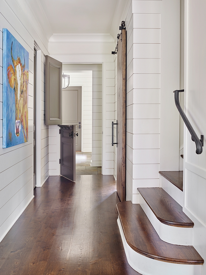 Hardwood Floors Throughout the Home is Oak Notice the stunning staircase with radiused treads and the grey Dutch-door leading to the mudroom Shiplap is painted in Benjamin Moore White Dove #hardwoodflooring #oak #shiplap #barndoor #shiplap #Benjaminmoore #Benjaminmoorewhitedove #Dutchdoors #staircase #radiusedtreads #staircasetreds