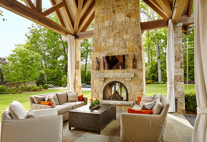 Stone Fireplace Outdoor Stone Fireplace The two-sided outdoor fireplace stone is Weathered Granite The same stone is used on the raised hearth and mantel Stone Fireplace Outdoor Stone Fireplace Stone Fireplace Outdoor Stone Fireplace Stone Fireplace Outdoor Stone Fireplace #StoneFireplace #OutdoorFireplace