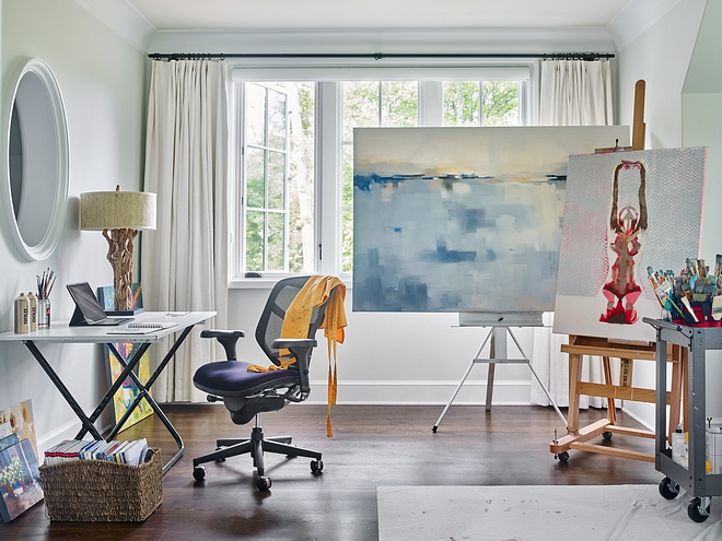 Casement windows bring an abundant amount of natural light to the homeowner's art studio #artstudio
