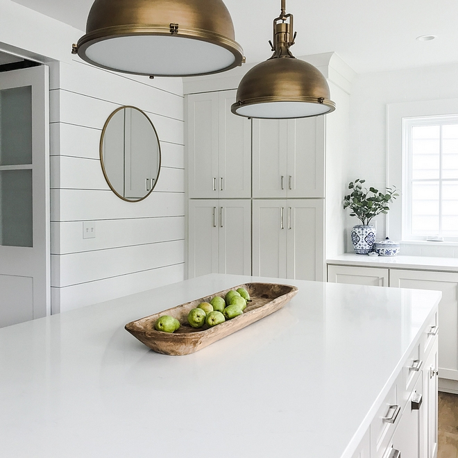 Silestone Statuario Quartz The kitchen countertop is Silestone Statuario Quartz It goes perfectly with the white perimeter cabinets and the grey island #SilestoneStatuarioQuartz #Quartz #countertop
