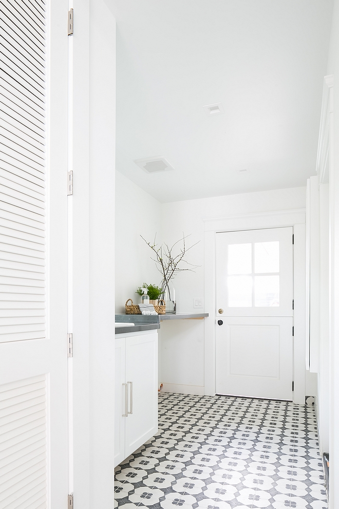 Pure White by Sherwin Williams The laundry room features white walls, painted in Pure White SW 7005 by Sherwin Williams and black and white cement tiles #PureWhiteSherwinWilliams #SW7005 #SherwinWilliams #whitepaintcolor #paintcolor