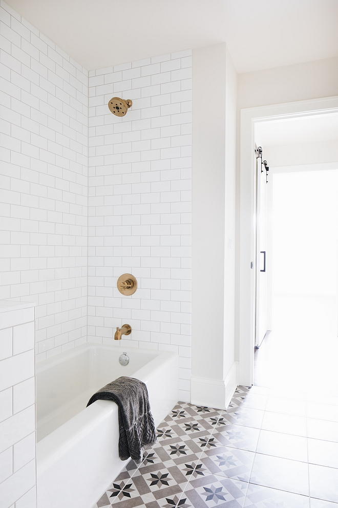 Kids bathroom featuring white subway tile bathtub and grey and beige cement tile as flooring #kidsbathroom #cementtile