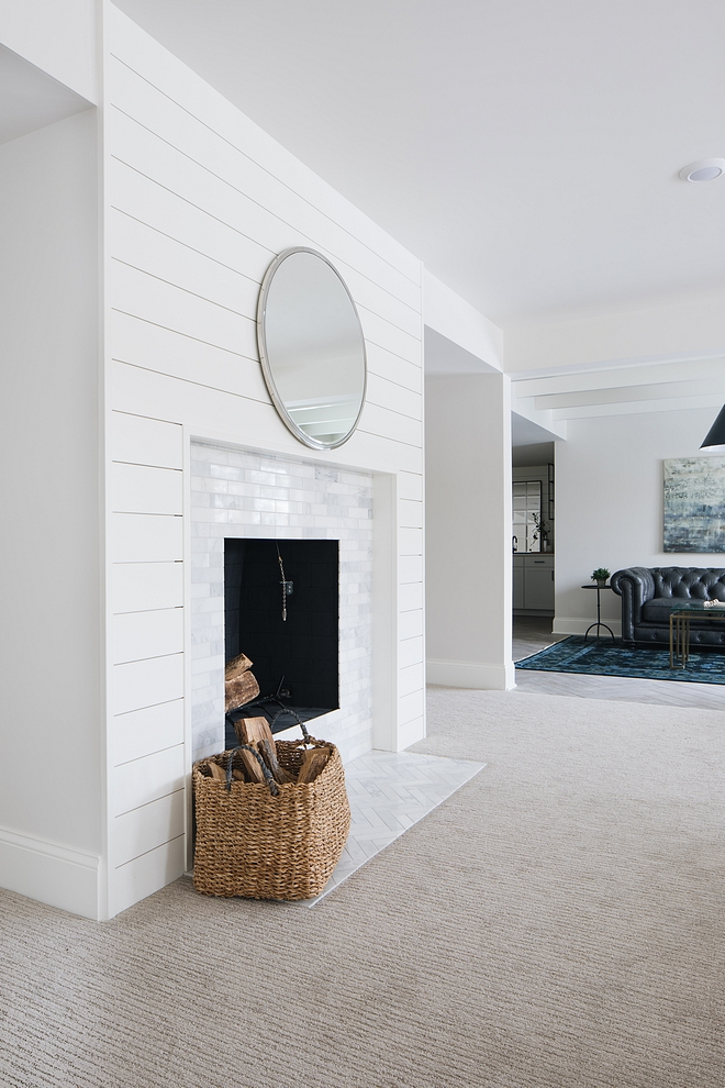 Without a mantel, the fireplace was kept simple, only featuring with shiplap and white marble tile, both in brick and herringbone patterns #fireplace #shiplap