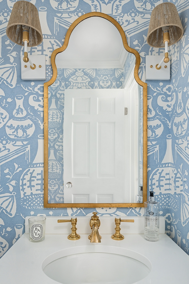 Bathroom Mirror Arched Brass Mirror against blue and white wallpaper and a pair Piper Sconces in Brass by Ro Sham Beaux Bathroom Mirror #Bathroom #Mirror