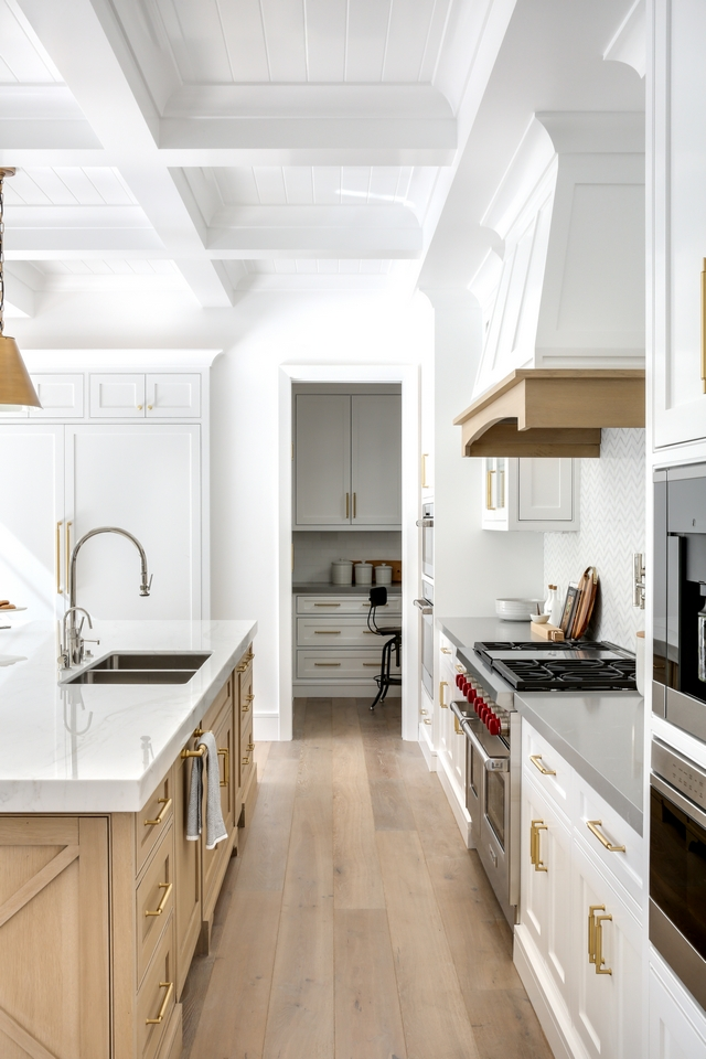 White Kitchen with White Oak hardwood flooring, White Oak kitchen island, White Oak kitchen hood trim and boxed coffered ceiling with tongue and groove #kitchen #WhiteKitchen #WhiteOakhardwoodflooring #hardwoodflooring #WhiteOakkitchenisland #WhiteOakkitchen #kitchenhood #hoodtrim #boxedbeamceiling #cofferedceiling #tongueandgroove
