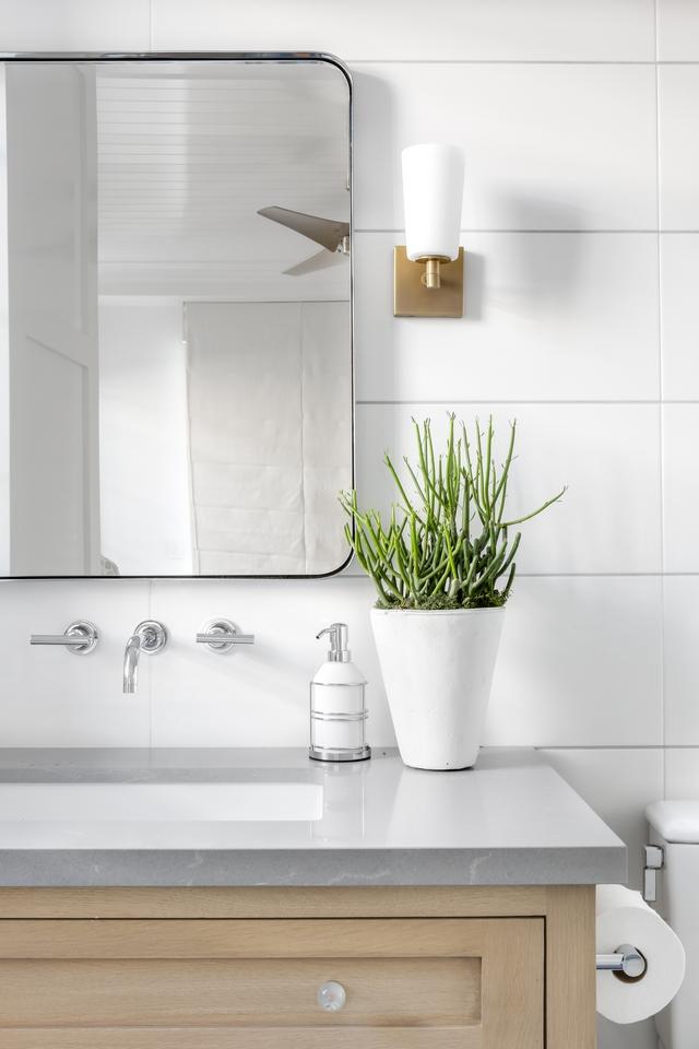 Bathroom shiplap tile and grey countertop Countertop is Grey Savoie Quartz, polished #bathroom #bathrooms #countertop #tile