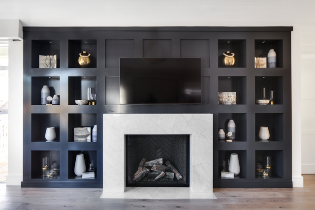Jet Black Built-in Bookcase Jet Black Built-in Bookcase with white marble fireplace surround Jet Black Built-in Bookcase