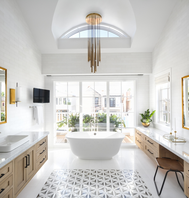Bathroom windows This master bathroom is outstanding from every direction and don't worry about the windows... the large window we see ahead features motorized blinds #bathroom #windows #motorizedblinds #automaticshades