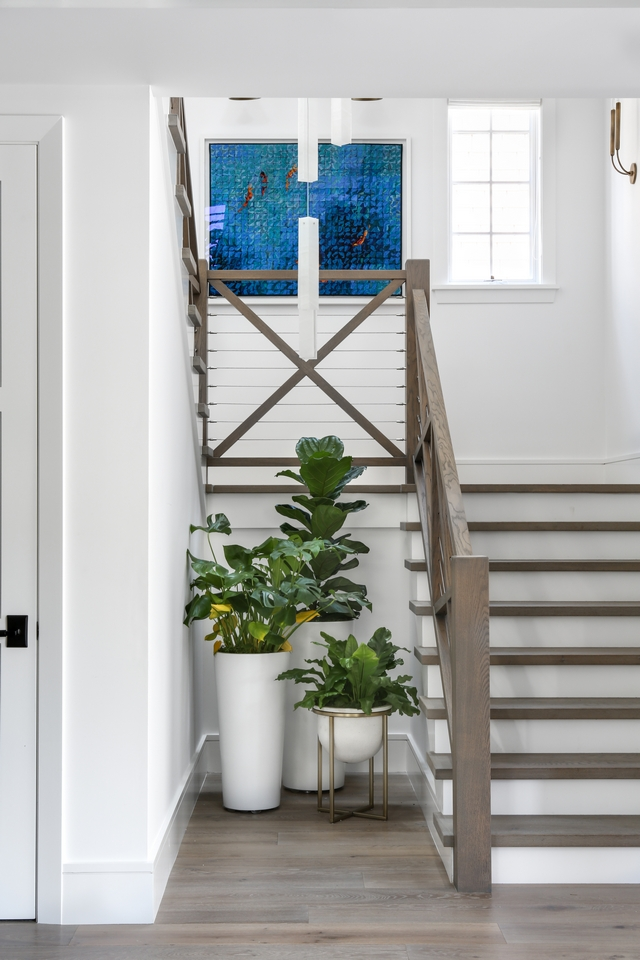 Farmhouse Staircase Railing The modern farmhouse-inspired staircase features wood and wire railing Farmhouse Staircase Railing Farmhouse Staircase Railing #FarmhouseStaircase #FarmhouseStaircaseRailing #woodandwirerailing