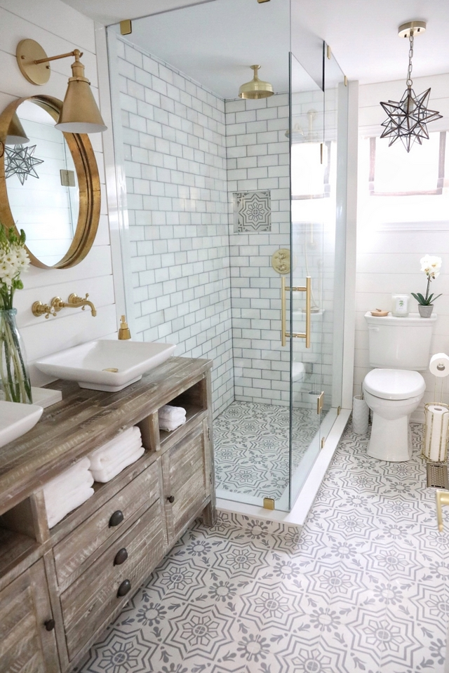 Bathroom Renovating Bathroom featuring grey and white cement floor tile, white marble subway tile on shower and a distressed Rough Sawn media cabinet transformed into vanity #bathroom #renovation #cementtile #bathroomrenovation #reno