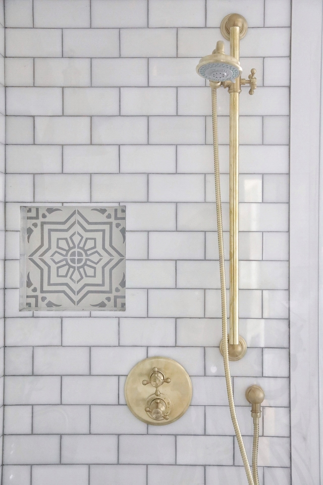 Shower Nook The homeowner added a shower nook for shampoo and soap using the same cement tile pattern #showernook