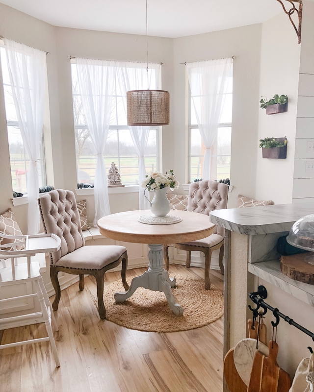 Farmhouse kitchen nook Kitchen nook is our favorite breakfast spot/ laundry table. We love to eat here and the kids help me fold laundry and look out the windows to see the horses #farmhosue #farmousenook #kitchennook #breakfastnook