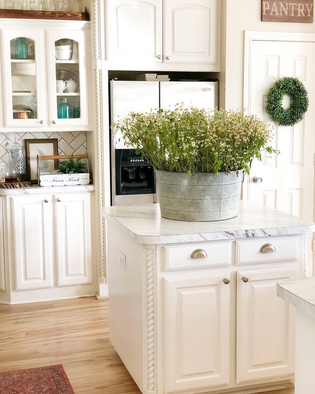 Kitchen cabinets are painted in Glidden Grab-and-go for high traffic areas in semi-gloss white